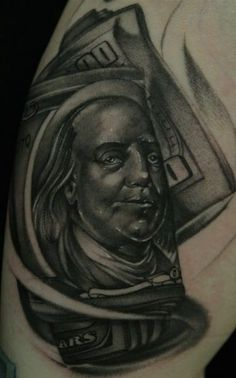 This money tattoo features a face from money and so it doesn't merely represent the almighty dollar, but it invokes the impression of history of humanity. By making the face of a person as well as the association with a great deal of money the focal point of this tattoo,   #tattoos  #tattoofriday #tattooart #tattoodesign #timeismoneytattooideas  #moneytattoosonhand #moneytattoodrawing #smallmoneytattooideas