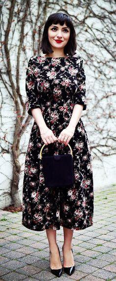 Floral dress black hair fair skin red lip