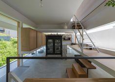 Tato Architects divides house into offset horizontal volumes