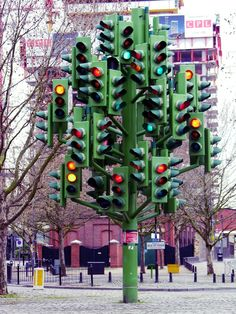 Traffic-light-tree by Pierre Vivant. The sculpture was created to mimic a tree structure and reflect the energy of the developing Canary Wharf area. London, UK.