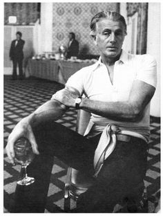 Givenchy  Hubert de Givenchy, one of the most talented and famous fashion designers of all time, relaxes before his show at the Waldorf Astoria's Ball Room in 1976. He's wearing a fitted polo shirt, some jeans, and what appears to be a scarf wrapped around his waist, classic and avantgard 70s style.