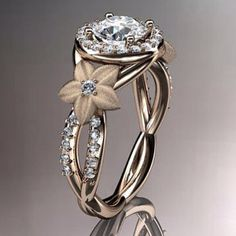A ring to die for! I love this because the flowers on the sides remind me of Plumeria's