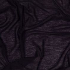 Looking for a light-weight sheer jersey knit? Then you have come to the right place! Dark midnight purple in color, this silk-viscose jersey fabric contains a nice amount of stretch in the weft, a slight stretch in the warp, is very fine, and is completely sheer. With it's phenomenally soft drape and immensely soft hand, turn this spring/summer fabric into cute t-shirts, sheer tops, or comfy cardigans.