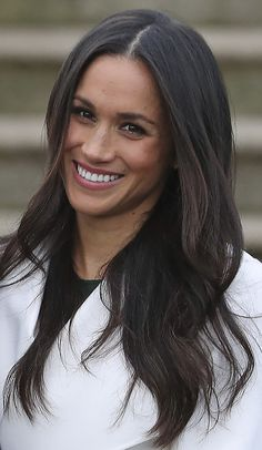 US actress Meghan Markle shows reacts as she poses with her fianc� Britain's Prince Harry in the Sunken Garden at Kensington Palace in west London on November 27, 2017, following the announcement of their engagement.Britain's Prince Harry will marry his US actress girlfriend Meghan Markle early next year after the couple became engaged earlier this month, Clarence House announced on Monday.
