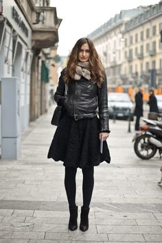 Love the combo of the though leather jacket and the feminine skirt.
