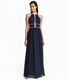 Dark blue. Long, dress in crêped woven fabric. Narrow-cut top with opening at front and short, narrow shoulder straps with fasteners at back of neck.