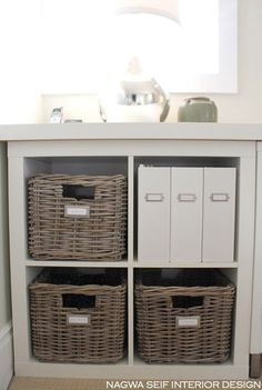 Minimize visual clutter. When it comes to paper storage, the easiest thing is to sort it all into matching containers. Woven baskets and bins along with simple white magazine files or kraft paper photo boxes are versatile pieces that can handle almost anything you have. Get a label maker if you don't like your handwriting, and stick on a fresh label each time you make a new bin or file.