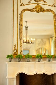 Amy Howard! Jazz up your mantle with simple zinc containers and moss. Love love love this. Need a large mirror for my mantle.