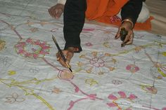 Women marking Naksha/Graph, (sketched and painted by Hand) before it is sent for weaving!