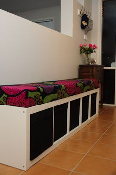 Bench seat with shoe storage made from an IKEA skinny bookshelf.