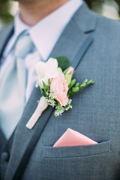 This is the look / including some jasmine and a white flower. Nigel and the best man's and Kahukura's (my grandson) colour scheme is a light silver grey, white and the green of these flowers. Fresh and bright.   Pale pink and white #boutonnieres.  Photography: Cluney Photo - www.cluneyphoto.com