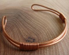 My Copper Bracelets & Copper Bangles are all Unique in design, made with bare copper wire and will tarnish with wear giving a fantastic ever-changing patina. If this bracelet isnt your size or you would prefer a custom style please let me know. <><><><><><><><><><><><><><><><><><> Handmade copper bracelet made from a single piece of copper wire. As this is handmade each one is different. The bracelet is made to order so please select the size at checkout. The pictured bracelet is 22cm and…