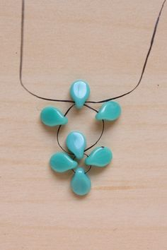 Flower Burst Spring Necklace: Use Pip beads and right angle weave to create this flower necklace.