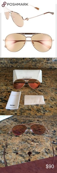 Modern authentic Michael Kors sunglasses Authentic rose gold Michael Kors sunglasses. These beauties are a modern version of the classic aviators. They are lightweight, super trendy, and chic. The case has wear from being carried inside my purse, nothing major 6/10 condition. The glasses are in great condition. Minor scratches on the lens, barely noticeable. Michael Kors Accessories Glasses