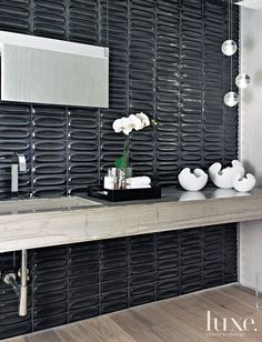 Hidden Potential: The Best In Powder Room Design...Gunmetal tile by Heath…