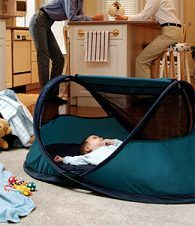 Kidco Peapod Travel Bed - a great alternative to lugging around those heavy, not so portable playpens.  This folds up into a bag the size of a large dinner plate.  It has a self-inflating mattress and a bug screen you can zip up if you use it outside.  Comes in two sizes and a variety of colors. I want one.