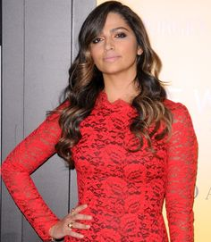 Camila Alves wearing a red lace Dolce & Gabbana long-sleeved dress