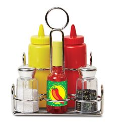 A must-have for the well-appointed play kitchen, these condiments sound and look like the real thing! Packaged in a handy metal caddy to keep everything organized, the six-piece set includes ketchup, mustard, salt, pepper, and hot sauce. Best of all: The salt and pepper really shake, the hot sauce really pours, and the ketchup and mustard squirt string! These wonderfully durable play pieces are built to last through countless culinary adventures.