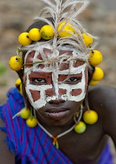 Surma kid with fruits and plants decoration - Kibish Ethiopia by Eric Lafforgue, via Flickr