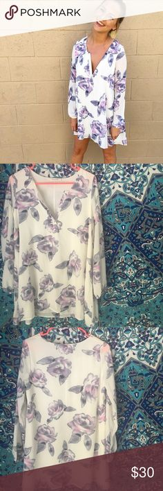 NWT floral boutique dress NWT, Perfect condition, popular dress that sold out at every boutique that it was sold out. Selling it at a fraction of the price it was sold at in store. Little wrinkled from sitting in my closet, just needs to be ironed. Tagging show me your Mumu for similar style Show Me Your MuMu Dresses Mini