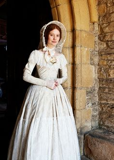 Jane Eyre - Mia Wasikowska wearing her wedding dress, made of brocade with lace flounce on the skirt and around the neckline. The dress is completed bygone fingerless lace gloves, a white hat with a ribbon to tie under the chin and white embroidered veil. Mia Wasikowska, Movie Wedding Dresses, Wedding Movies, Wedding Gowns, Lace Wedding, Jane Eyre Movie, Jane Austen, Jane Eyre 2011, Victorian Fashion