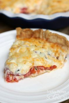 The BEST Tomato Pie recipe from TastesBetterFromScratch.com  Layered with fresh tomatoes, onions, basil, and a delicious cheesy filling! #tomato #pie