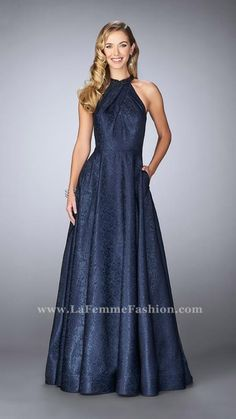 Charming jacquard dress with full A-line skirt and high pleated neckline. The dress features pockets and beading at the neck. Back zipper closure. Navy Mother of the Bride Dress Style 24888 | La Femme