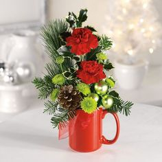 Santas mug Christmas floral arrangement Christmas Flower Arrangements, Christmas Flowers, Christmas Centerpieces, Christmas Mugs, Christmas Projects, Floral Arrangements, Christmas Wreaths, Christmas Decorations, Christmas Floral Designs