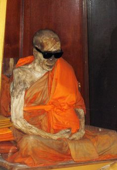 Mummified body of Loung Por Daeng, born in 1894, a Buddhist monk, who predicted his own death, which occurred at 1973.  More about him: http://www.thailandselection.com/attraction/The-Mummified-Monk.html