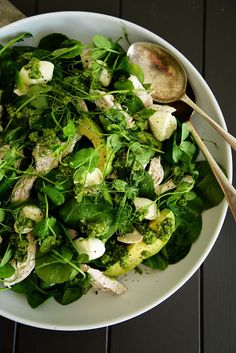 healthy spinach and chicken salad with avocado, pea shoots, fresh mozzarella and pesto