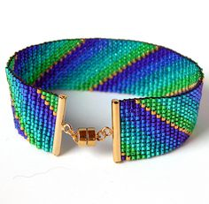 """Paper Clip Loom Bracelet - bead loom--The designer said that the ends shown here are called """"Toobs"""" and are available from BeadCats.com. They only have a few sizes and only fit size 11 beads.. I added the magnetic closure.--Don't see why I can't recreate this with beadwork instead of a loom."""