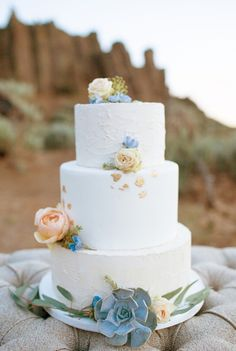Boho + simple wedding cake idea - three-tier wedding cake with buttercream + fondant frosting and succulent + floral details {Kayla Jannika Photography}