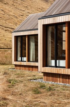 The rugged isolation of Banks Peninsula in New Zealand is the context for this holiday house by Patterson Associates. Andrea Stevens discusses the remarkable setting and how the architecture works to create a sense of belonging. Wood Architecture, Residential Architecture, Architecture Details, Timber Cladding, Exterior Cladding, Ideas Cabaña, Shed Homes, Glamping, Building A House
