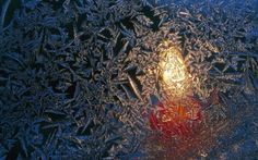 Chrisrmas Holiday Lights Wallpapers - Frost pattern on window, with candlelight shining through Wallpaper 7