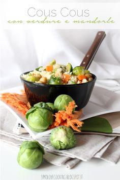 Cous cous con carote cavolini di bruxelles e mandorle
