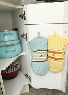 hang oven mits inside the cabinet.