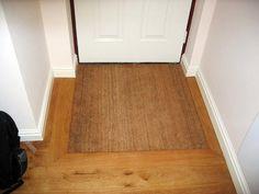 Attirant Example Of Inset Recessed Door Mat On Wood Floor