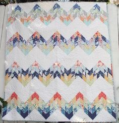 Misty Mountain Quilt Pattern - love the fabrics used does look like misty mountain tops.