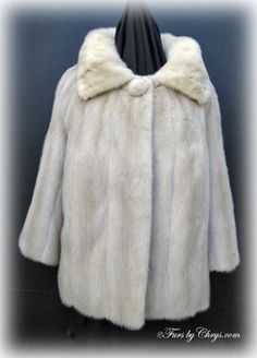 "Tourmaline Mink Jacket TM736; $750.00; Very Good Condition; Size range: 10 - 14 Misses or Petite. This is a stunning genuine natural tourmaline mink fur jacket. It has a ""Tourmaline EMBA Natural Pale Beige Mink"" label and features a large wing collar.  It has 3/4 sleeves, but they could be let down by a seamstress or furrier to be standard length, if you desired. This tourmaline mink jacket is just what the doctor ordered to remedy your wardrobe! Wear it and feel the excitement begin!"