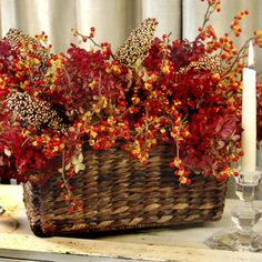 Collect branches and berries from your backyard and mix with dried flowers. Add an assortment of colorful leafy sprigs to bring texture and vibrance to your arrangement.