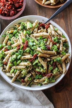Kale Pesto Pasta Salad with Sun-Dried Tomatoes and Broccoli - a healthy side dish for summer BBQs and picnics | TheRoastedRoot.net #glutenfree