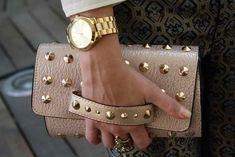 Hand strap clutches.