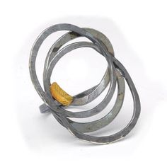 Paulette Werger: Orbit Ring, Oxidized sterling silver, and 18k yellow gold. Size 7. (May be sized to fit)