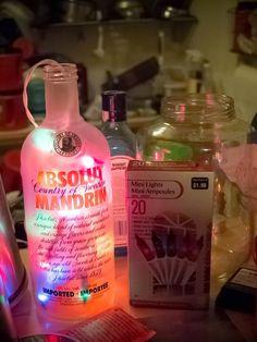 DIY  ::  Simple decoration ( Vodka bottle with mini lights ) (or other jar)
