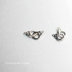 Hey, I found this really awesome Etsy listing at https://www.etsy.com/listing/294773465/2pcs-silverrhodium-handcuff-charms-two