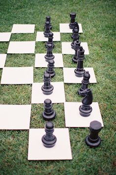 this have me an idea, Caris...wouldn't need but one set if tiles at first....garden wedding. alice in wonderland. lawn chess.
