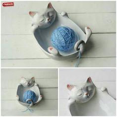 Gato porta ovillo