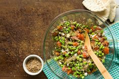 Bulgur, pesto, edamame, tomato salad (those sad looking things are the tomatoes).  Add the feta as you serve it or it will cling to that bulgur like dried snot.  I skip the pita.  Sometimes I eat it along side my feta, chard med. turkeyballs.  YUM!