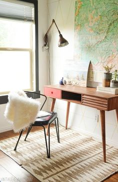 Vintage modern home office in the living room. Great mid-century desk with map on the wall. geometric rug provides a great contrast. guest bedroom home office desk Office Inspiration, Decoration Inspiration, Decor Ideas, Office Ideas, Office Decor, Entryway Decor, Rug Ideas, Home Interior, Modern Interior Design