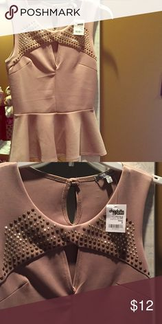 NWT Studded Peplum Top New with Tags, beautiful taupe color peplum top with studded detailing along the top with a sexy cut out. Very flattering on all body types. 95% polyester & 5% spandex. Charlotte Russe Tops Tank Tops